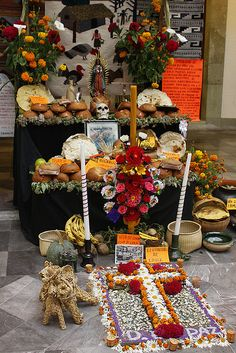 """Traditions connected to """"Dia De Los Muertos""""  include building private altars honoring the deceased using sugar skulls, marigolds and the favorite foods  beverages of the departed and visiting graves with these as gifts. They also leave possessions of the deceased."""