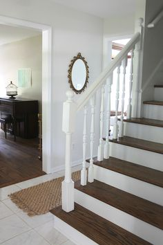 A pretty & functional foyer on a budget. Get the tips, tricks & concepts that made this space work!