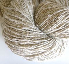 Eliade on Etsy. Natural tones organic hemp/Bourette silk/nylon blend, textured single-ply, sport weight yarn.