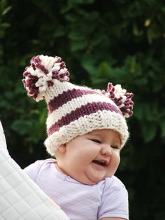 This adorable $5 baby hat pattern is perfect for keeping little ones cozy on colder days.  Embellish with pom poms to create a simple irresistible hat!