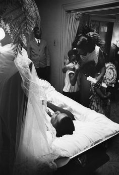 The Authority Behind Her Words -- FIFTY YEARS before her prayer at the Inauguration in 2013 -- Myrlie Evers comforting her three children at the casket of Medger Evers, WWII combat veteran and dedicated NAACP Field Secretary for Mississippi. He was shot dead in their home's driveway, as part of a sustained campaign of terror by white supremacists; his murderer was brought to justice in 1994. Photo ©Flip Schulke, 1963. Medgar's life story: http://en.wikipedia.org/wiki/Medgar_Evers