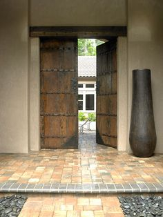I want an entrance like this to my home with a courtyard behind these doors before you get to my front door. LOVE! Ditto!