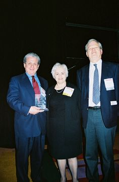 Executive Director, Arnita Jones, and Former President, James Sheehan, presenting what looks to be the Roosevelt-Wilson Award at a past annual meeting