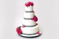 Ivory wedding cake with black stencil detailing, silver teardrop embellishments and sugar peonies, by Ron Ben-Israel.