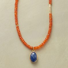 "TIERRA DEL FUEGO NECKLACE -- Faceted lapis rimmed in 14kt vermeil marks the southernmost tip of our exclusive carnelian strand. 14kt goldfill beads, turquoise heishi, hook clasp. Handcrafted in USA. 17""L."