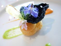 Pecorino filled beignet with squid ink crispy rice chip from Le Nuvole in Suvereto #molecular  #gastronomy