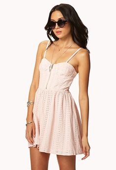 An eyelet dress featuring a sweetheart neckline with a shaped bust and underwire cups