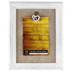 Studio Décor Viewpoint Savannah Distressed Wood Frame, Burlap & Flower Clip with burlap backing and a metal clip shaped like a rose to hold your photo. The distressed frame has an aged appearance that gives it vintage charm. There is no glass, so you can quickly and easily change out the image you are displaying.