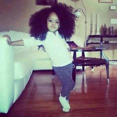 This little girl is inspiring me to wear my curly swirly fro too! :p
