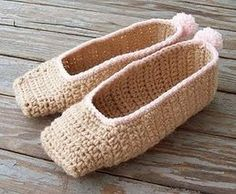 Simple crochet patterns like these sweet slippers are fun to make. You can make a pair for yourself and then make another to give as a gift. The pom at the heel makes a great embellishment.