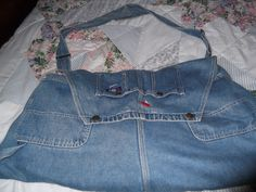 This is my denim overall purse, handy pockets already in place, used the buckled straps too! Lined with Pink Bandana John Deer fabric.  Big enough for an overnite bag.