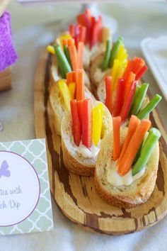 Veggies and dip in individual baguettes-what a great idea for a party!