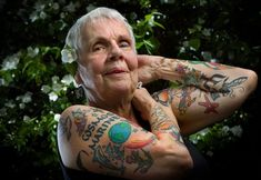 """Chicago resident and grandmother Helen Lambin likes it when young people stop her on the street to give her compliments on her tattoos, or when they simply yell out, """"Nice ink!"""". She enjoys the fact that her tattoos have helped create connections with strangers, of different generations and cultures. The idea for getting a tattoo came to her three years ago when she was feeling down about growing older. One led to another, and then another.  Now that's some awesome shit!"""