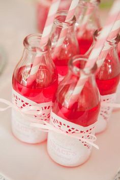 Glass Bottles + doilies + striped straws = cute party idea!
