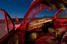 """Night photos reveal 'Lost America'    Since the 1970s, fine art photographer Troy Paiva has been exploring junkyards and ghost towns. After a night photography class in 1989, Paiva said he knew he wanted to connect a sparsely lit style with abandoned lots. He bought his first """"real camera"""" and went to work."""