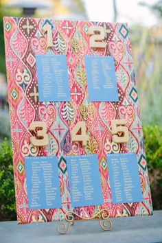 We love this seating chart incorporating fun fabric and gold numbers.