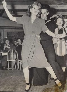 Rita Hayworth leads a conga line at the Stage Door Canteen during WWII