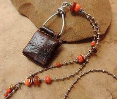 Antique Ethiopian Leather Talisman with Antique Coral and Carnelian Beads, Thai Hilltribe Silver and Antique Steel Cut Beads