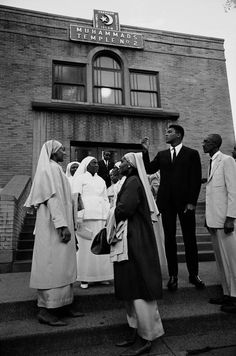 1966. Chicago. Muhammad Ali talks with Nation of Islam women outside a Southside Muslim Temple.