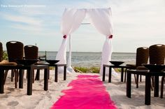 Getting more and more popular - the sand wedding aisle. A colorful footprint in the sand