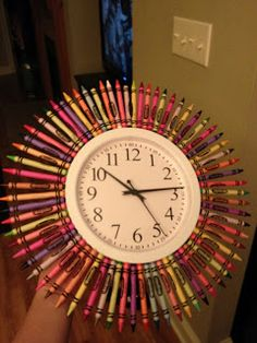 Another creative clock decoration. Use a large cardboard circle with a hole in the center for the clock. Glue on Crayons (markers, pencils, etc.). Attach to wall over clock. Make several and change each semester. (If clock top is close to ceiling, the crayons and pencils can be trimmed to fit.) teacher gifts, crayon, classroom decorations, classroom clock, kindergarten classroom decor, kid rooms, play room decor, paper plates, awesome classroom decor