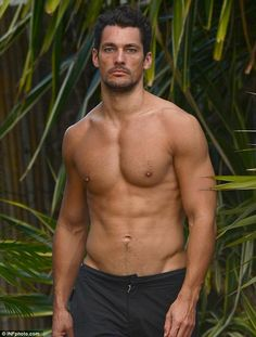 Picture perfect: David Gandy goes topless by the pool in Miami, Florida, on Tuesday afternoon
