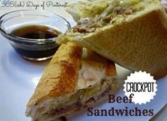 Slow cooked and tender, the jus for these beef sandwiches is packed with flavor and garlic cheese bread just takes it over the top! #crockpot #beef