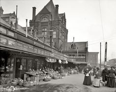City Market: 1906 - Its days as the center of business past, the City Market still bustled with produce vendors in the early 1900s.  Streetcar tracks crossed and curved where Fifth and Walnut streets met.