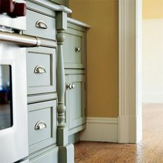 """Cabinet corners don't have to be plain, straight edges. Here, a half post marks the transition between cabinets of different depths. Shown: Colonial-style """"split-leg"""" in painted maple, about $500; available from Front Row Kitchens. 