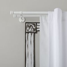 Button Cap Double Rod (White) - so you can hang blackout panels and cute window panels - making the room dark for baby but cute too