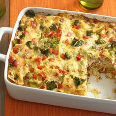 A variation of the traditional red-sauced recipe, this luscious lasagna is layered with Alfredo sauce, noodles, and a crab mixture. A sprinkling of red peppers and broccoli completes this one-dish meal.