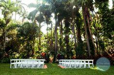 Simple, elegant outdoor garden wedding ceremony at Sunken Gardens in St Petersburg, Florida. Photo by In True Colors.