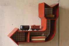 red arrow cubby | red arrow shelves | metal storage | wall sculpture