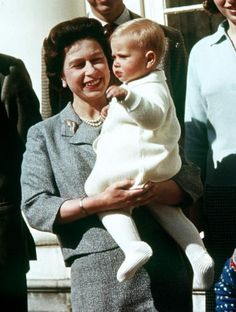 The Queen holding Prince Edward. April 21, 1965.