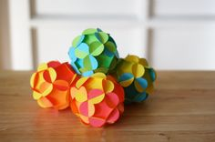 DIY 3D paper ornaments. These pretty paper ornaments can be customized for any occasion or holiday simply by changing the color of the paper you use. Add string and hang them. With graduations just around the corner, I think these would make great party decorations - just use paper in school colors.