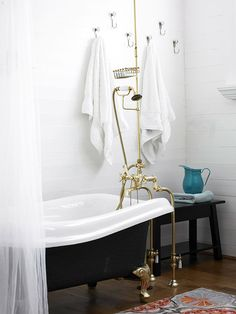 claw foot tub + brass plumbing/fixtures