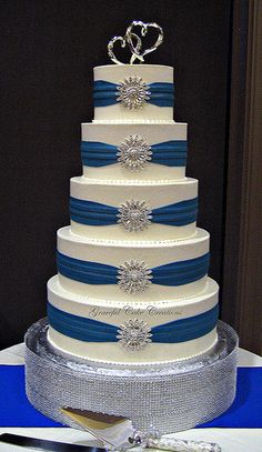 Elegant White Buttercream Wedding Cake with Royal Blue Sashes and Silver Brooches   Flickr - Photo Sharing!