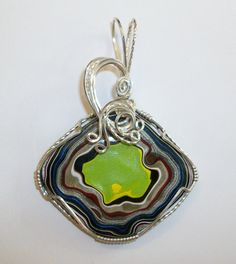Fordite Fusion Wire Sculpted Pendant in silver by JoaniesCreations, $102.00