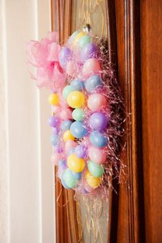 Easter WREATH made out of PLASTIC EGGS! Via Kara's Party Ideas | KarasPartyIdeas.com #easter #egg #wreath #tutorial #decorations #decor #ideas #party #spring