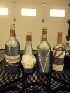 Spray paint wine bottles and glue away!