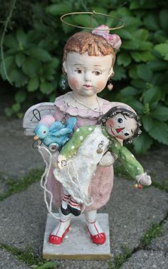 Angel of Playtime with her favorite dolly by Debbee Thibault.