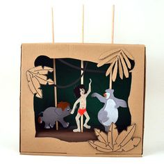 How To Make a Jungle Book Shoebox Puppet Theater: Got a spare shoebox lying around? Recycle it into a Jungle Book-themed puppet theater to inspire imaginative play with Mowgli and friends. There is nothing more satisfying than transforming a cardboard box into a toy that inspires play for little hands.  Older children and parents can prepare the box. Young kids will love to draw the puppets and play with the theater.