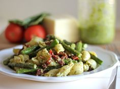 Pesto Pasta with Sun Dried Tomatoes and Roasted Asparagus - from Damn Delicious