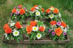 Simple flower arrangements in terra cotta pots