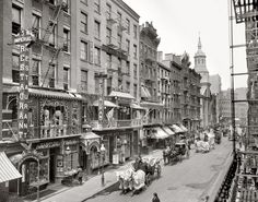 """""""Funeral procession on Mott Street,"""" Chinatown, New York City 1905. Hearse is the third horse-drawn vehicle. canal 26, idea canal"""