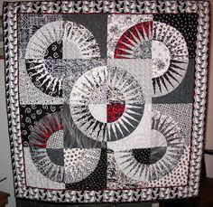 Black, white and red New York Beauty quilt at BeeWitchinStitchin