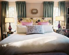 Curtains, cushions and patterned headboard.