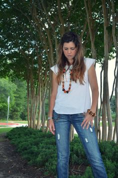 distressed jeans and white t-shirt. classic look. orange accessories.