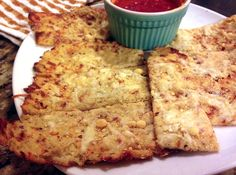 Garlic Cauliflower Breadsticks   -- I'm in love with these and they're so wonderfully garlicky! Even sprinkled a little more on before the 2nd bake. Only 6 carbs in the whole thing! #lowcarb #keto #atkins