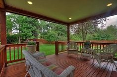 Covered back deck w/ Pod Lighting. Our farmhouse has one just like this!